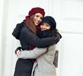 Happy women embracing on a cold winter two outdoors Stock Photography