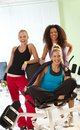 Happy women at the gym smiling having break Stock Photo