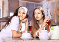 Happy women on kitchen Royalty Free Stock Photography