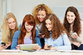 Happy women learning tablet computer smartphones university class Royalty Free Stock Photography