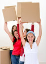 Happy women moving Stock Photography