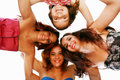 Happy women standing in huddle group of smiling low ange view Stock Photography