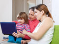 Happy women of three generations with laptop on sofa in livingroom Royalty Free Stock Image