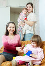 Happy women of three generations plays on the sofa in home Stock Images