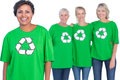 Happy women wearing green recycling tshirts on white background Stock Image