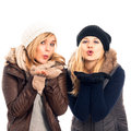 Happy women in winter clothes sending kiss Stock Image