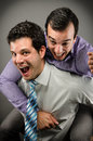 Happy at work image of two young business professionals having a good time Stock Photos