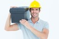 Happy worker carrying tool box on shoulder portrait of over white background Stock Images