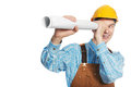 Happy worker in hardhat and overall with drafts Royalty Free Stock Photo