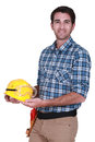 Happy workman holding his hard hat Royalty Free Stock Image