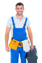 Happy workman in overalls holding toolbox portrait of on white background Royalty Free Stock Image