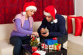 Happy Xmas couple eats biscuts Royalty Free Stock Image