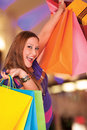Happy xxl shopping woman female holds bags background digitaly aded work path Stock Photography