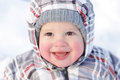 Happy year baby with rosy cheeks in winter outdoors Stock Images
