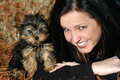 Happy yorkie puppy owner a miniature full blood with in the fall grass weather is smiling at camera Stock Images