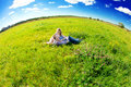 Happy young adult couple in love on the field two man and wom men women smiling resting green grass Royalty Free Stock Image