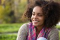 Happy young african american woman smiling outdoors Royalty Free Stock Photo