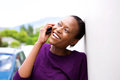 Happy young african woman making a phone call Royalty Free Stock Photo