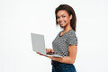 Happy young african woman using laptop computer. Royalty Free Stock Photo