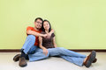 Happy young asian couples against green wall Stock Images