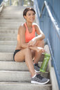 Happy young athlete a teenage sits on steps resting Stock Image