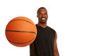Happy young basketball player with focus on the ball isolated white Royalty Free Stock Photography