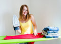Happy young beautiful woman ironing clothes housework Royalty Free Stock Photos