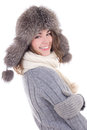 Happy young beautiful woman in woolen sweater and fur hat isolat isolated on white background Royalty Free Stock Images