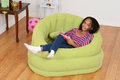 Happy young black child relaxing Royalty Free Stock Image