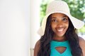 Happy young black girl with long hair and sun hat Royalty Free Stock Photo