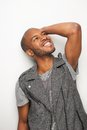 Happy young black man with hand to head portrait of a and looking up Royalty Free Stock Image