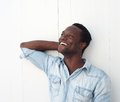 Happy young black man laughing outdoors portrait of a against white background Stock Photography
