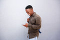 Happy young black man looking at cellphone Royalty Free Stock Photo