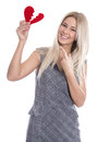 Happy young blond caucasian woman holding red heart and pointing with finger isolated on white love Royalty Free Stock Image