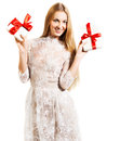 Happy young blond girl with presents Stock Photos