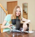 Happy young blond with new coffee maker in home interior cute living room Royalty Free Stock Photography