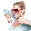 Happy young blond woman with thumbs up white background Royalty Free Stock Images