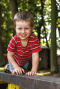 Happy young boy crawling on the ladder in park Stock Images
