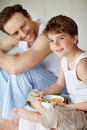 Happy young boy eating Stock Photography