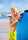 Happy young boy having fun at the beach on vacation with boogie board Stock Image