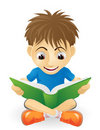 Happy young boy reading Stock Photo
