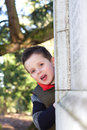 Happy young boy smiling in an outdoor scene Royalty Free Stock Images
