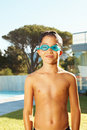 Happy young boy wearing swimming goggles Stock Image