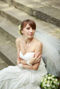 Happy young bride laying on steps summertime picture Stock Photo