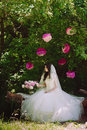 Happy young bride in a pink zone decorated with peonies in nature family relationships romance smiles hugs love lifestyle Royalty Free Stock Photography