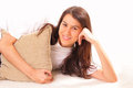 Happy young brunette woman with a pillow Royalty Free Stock Photos