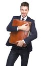 Happy young business man holding leather bag portrait of a on isolated white background Royalty Free Stock Photos