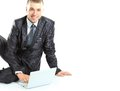 Happy young business man working on a laptop white background Royalty Free Stock Images