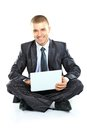 Happy young business man working on a laptop white background Royalty Free Stock Photo