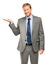 Happy young businessman showing empty copyspace on white backgro copy space Stock Photos